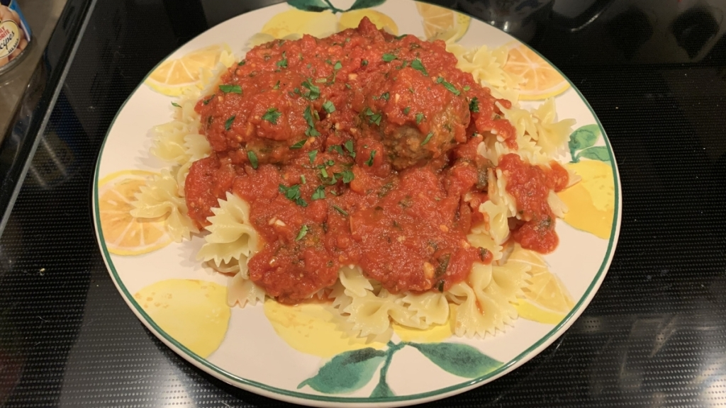 Bowtie pasta with meatballs.